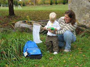 Child interacting with Nature Explorer Backpack